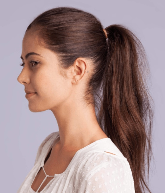 side view image of a woman with slick back hair and a voluminous ponytail - volume hair