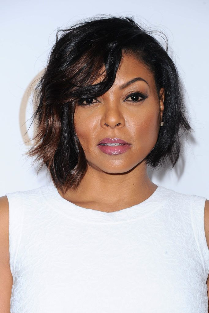black hairstyles with a bob: close up shot of Taraji P. Henson with a short, caramel wavy hair a-line bob, wearing white on the red carpet