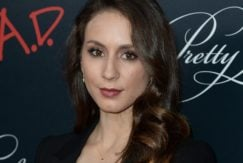 Troian Bellisario with long brunette hair