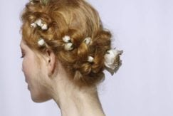 model with floral updo on wedding runway 2017