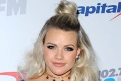 Witney Carson with blonde half up half down curly hair top knot