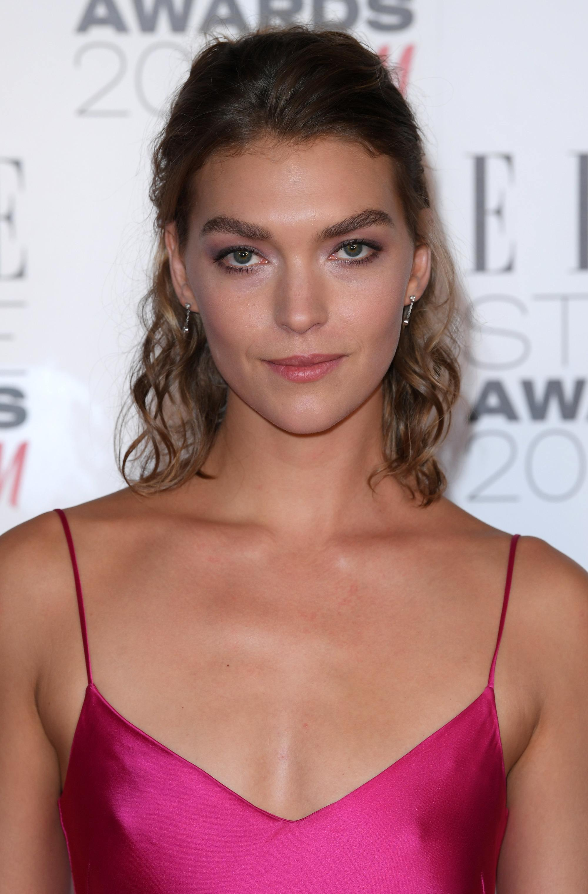 Arizona Muse at the elle style awards in a silk pink slip dress with tousled wavy hair
