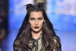 bella hadid with space bun wavy hairstyle on the anna sui runway