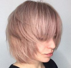 girl with a pink bob haircut with bangs