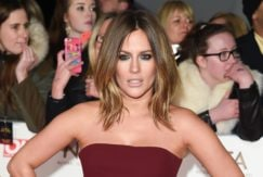 caroline flack on the red carpet in a burgundy dress with shoulder length blonde hair