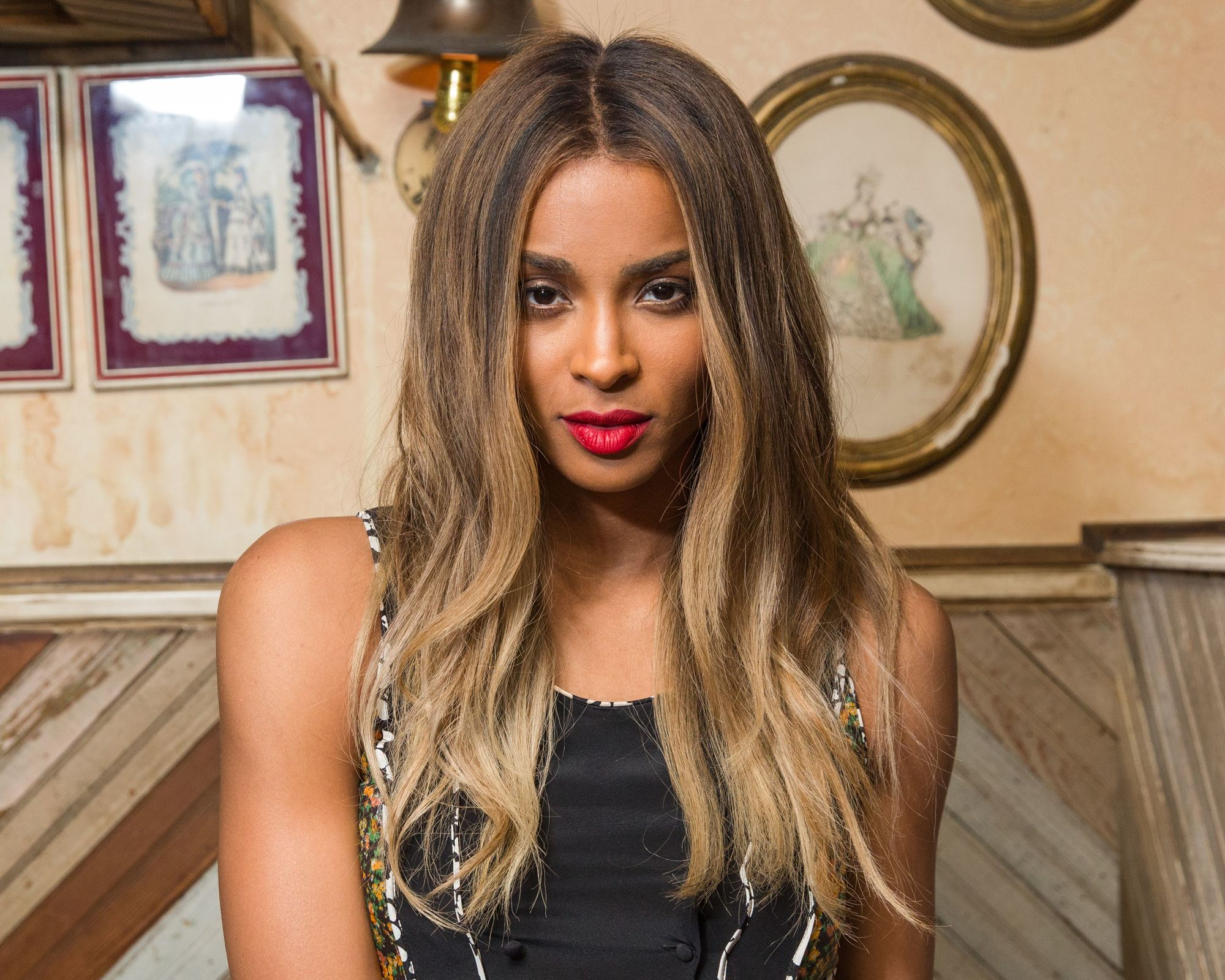 ciara with bronde wavy hair backstage at coach show