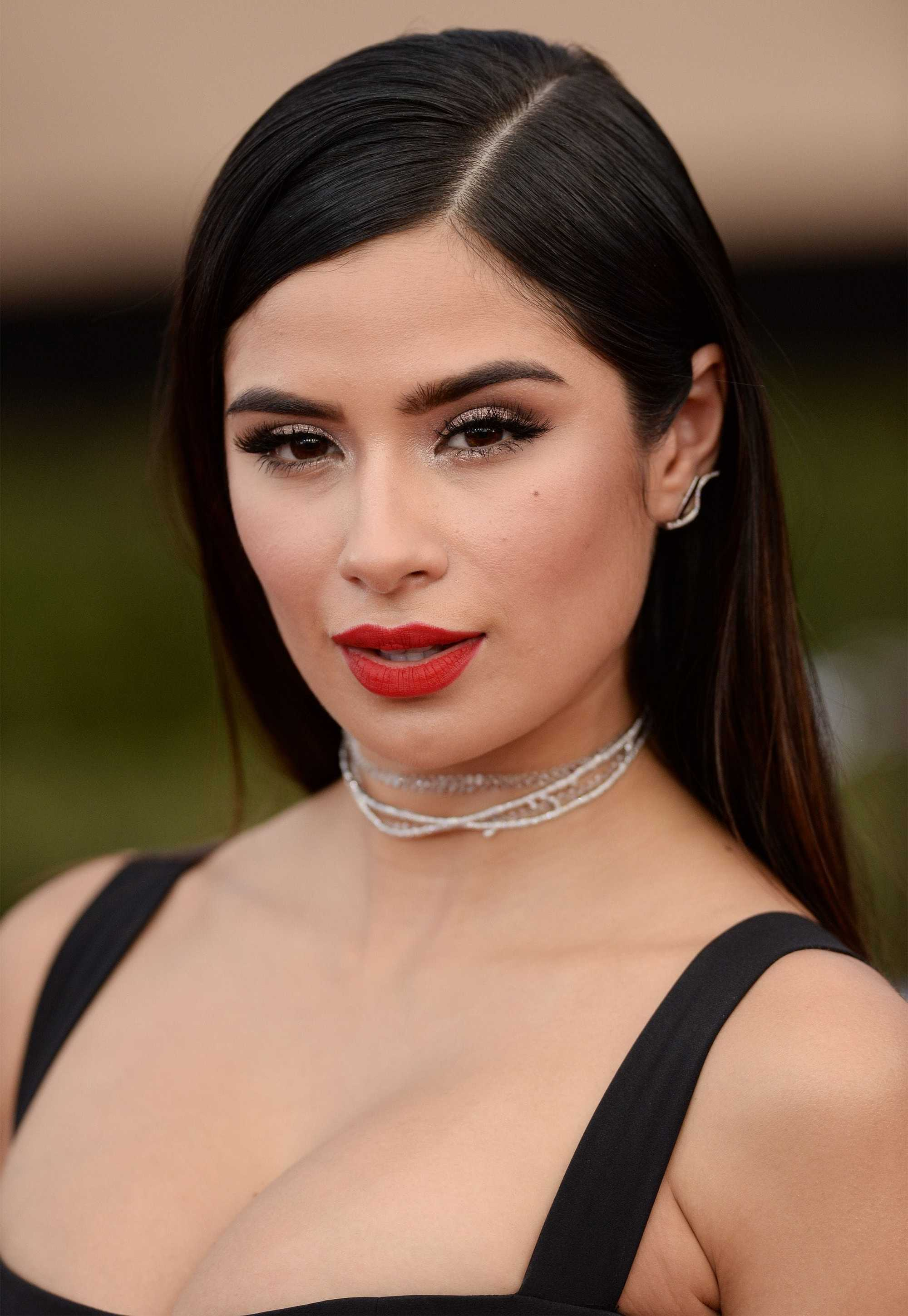 Sexy hairstyles for long hair: Diane Guerrero straight and sleek long brown hair