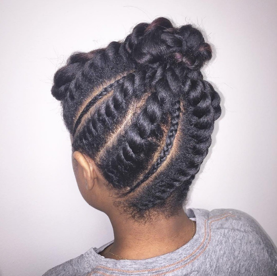 how to flat twist: black woman wearing grey tshirt with a flat twist hairstyle