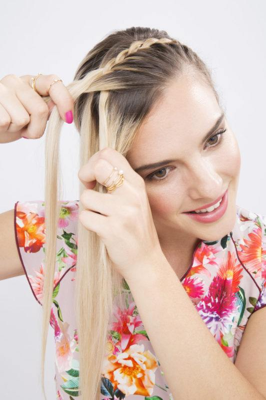woman with long blonde hair french braiding her hair aed78f8867d