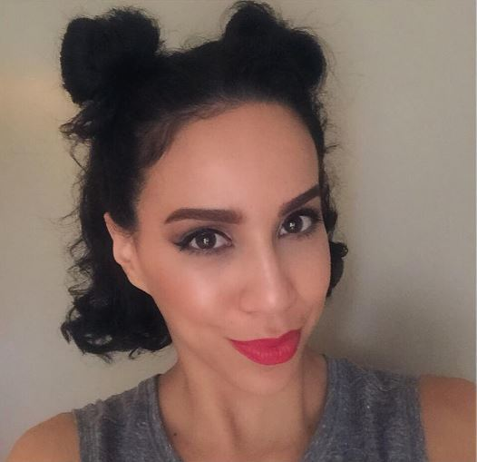 Short hair: Gym-ready dark haired woman with two half-up mini buns wearing red lipstick