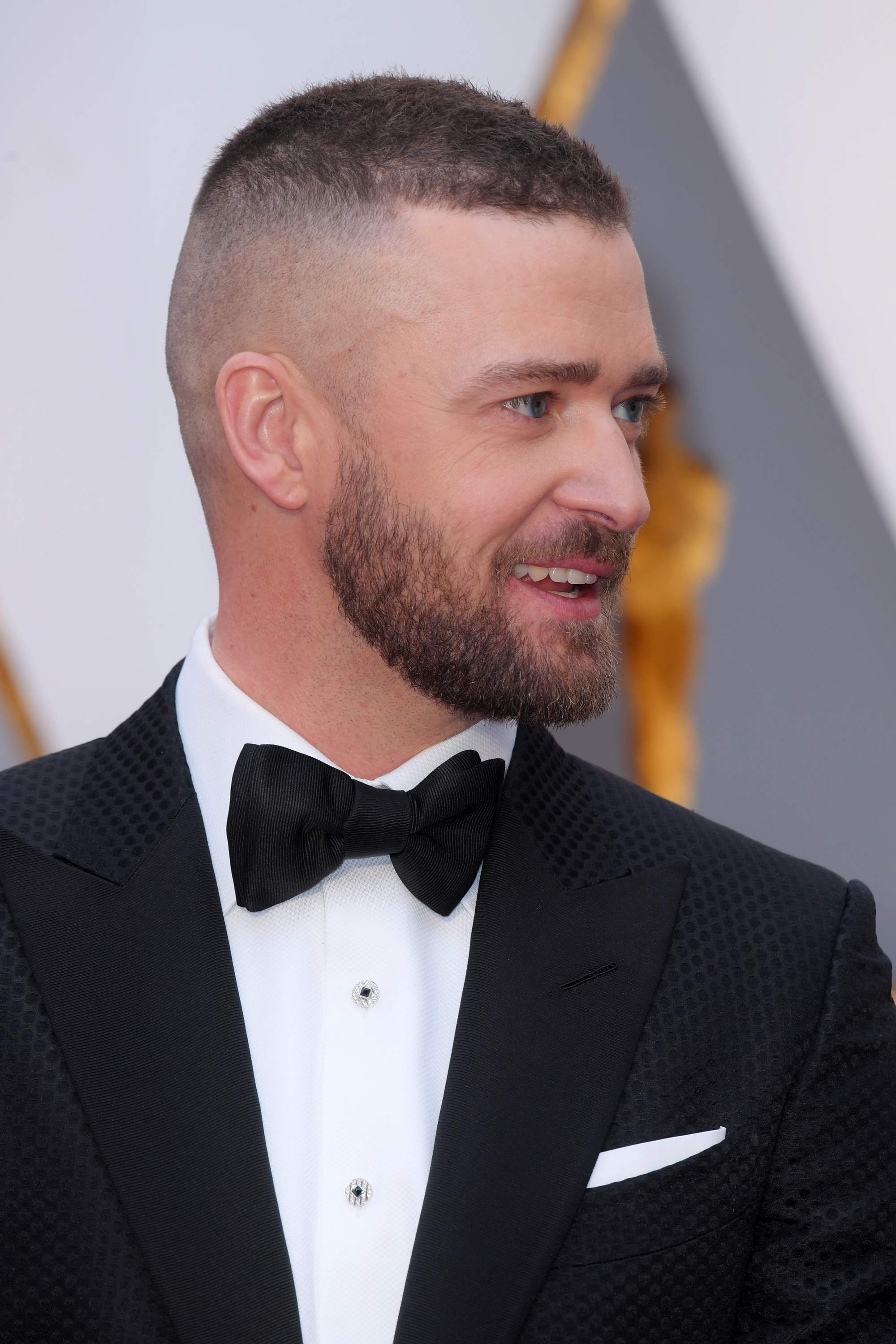 justin timberlake with short hairstyle in black suit and bow tie at the 89th Academy Awards