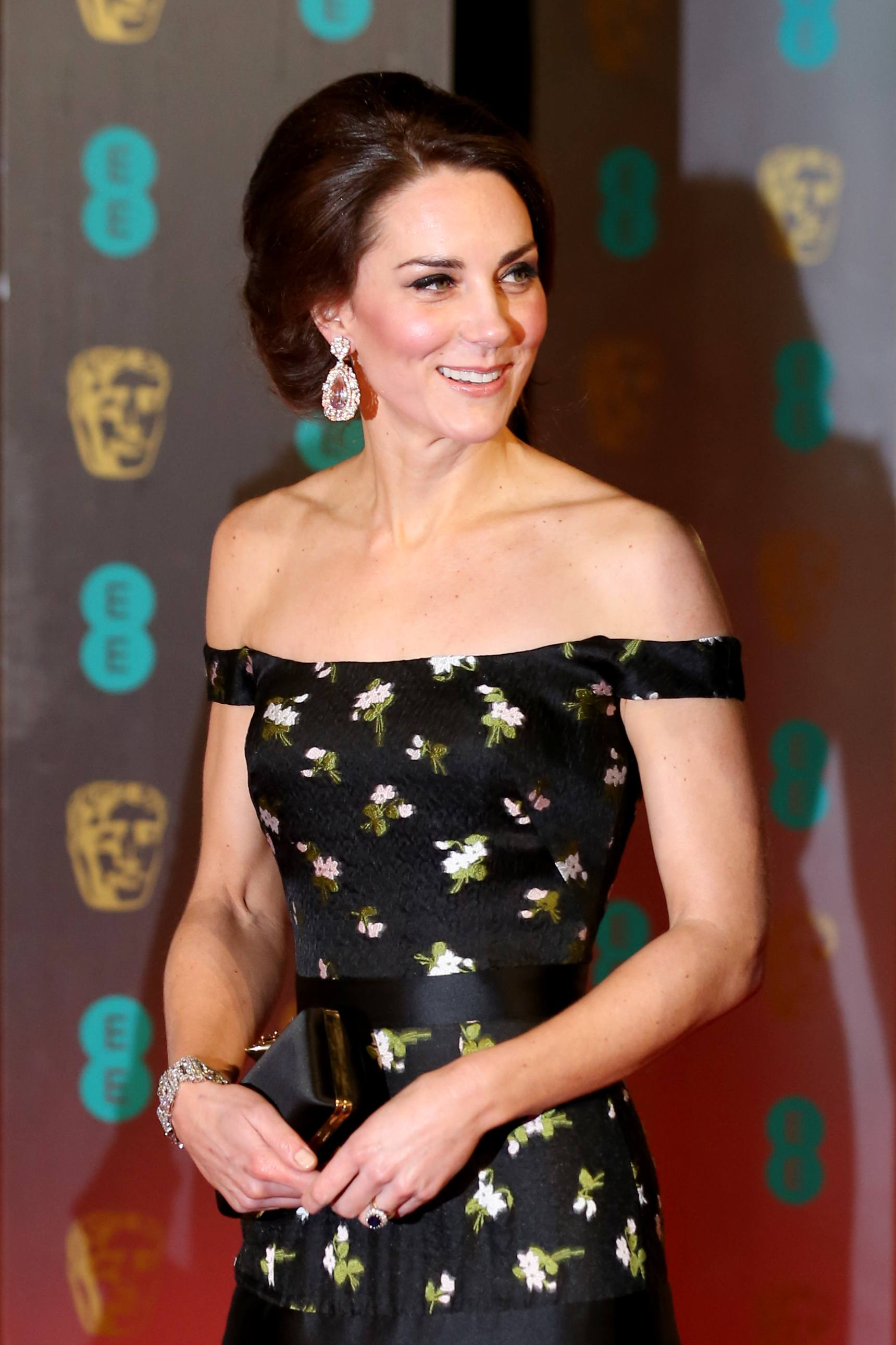 Kate Middleton wearing a floral strapless gown with her hair in an updo
