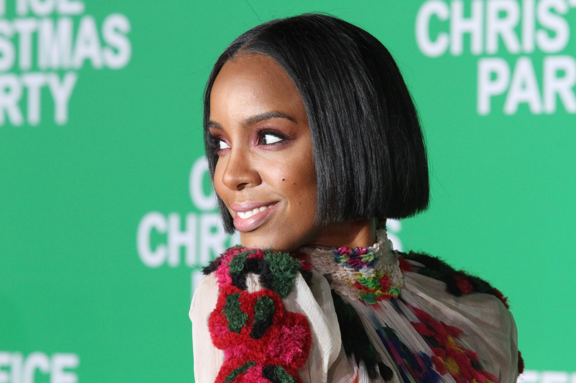 kelly rowland in a colourful dress with a short black bob haircut