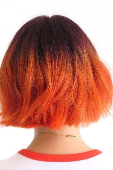 short ombre: model with citrus coloured orange hair and short choppy bob