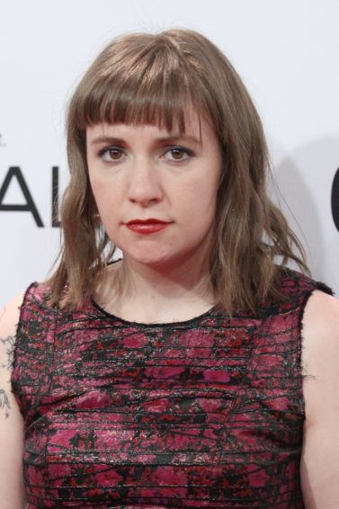 Lena Dunham with brunette hair with bangs