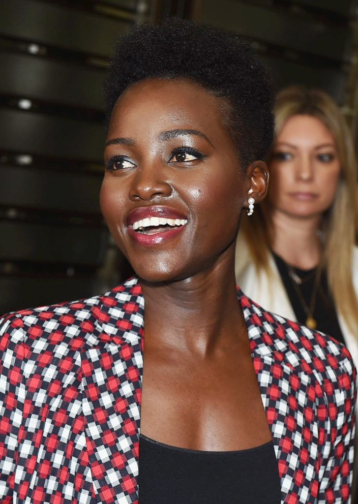 close up shot of lupita nyong'o with high top afro with tapered afro