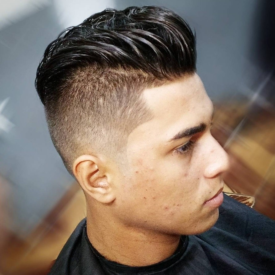 man with shaved high fade haircut