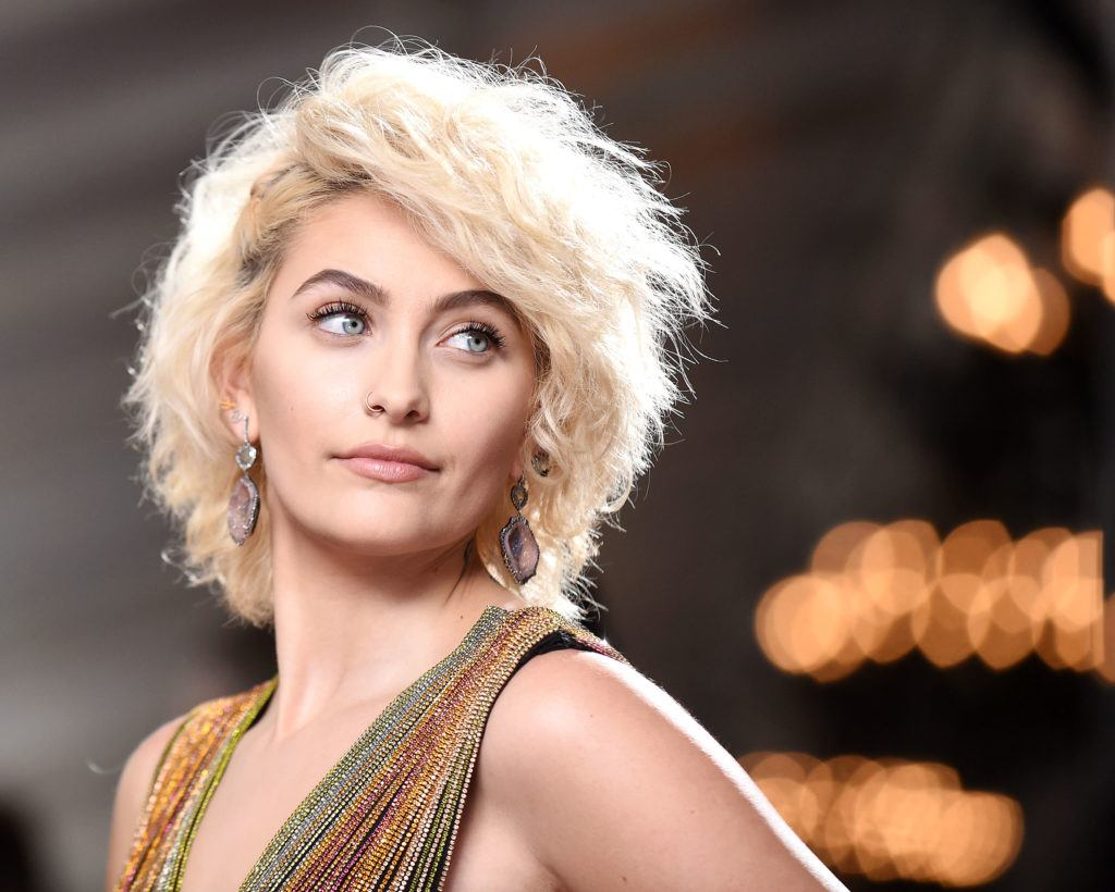 paris jackson wearing glittery gown with blonde curly hair