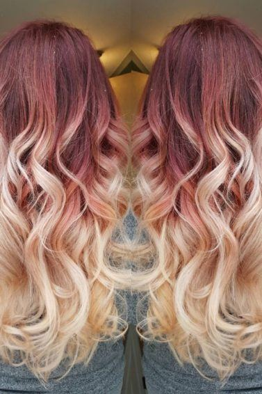 girl wearing grey top with long curly red to blonde ombre hair
