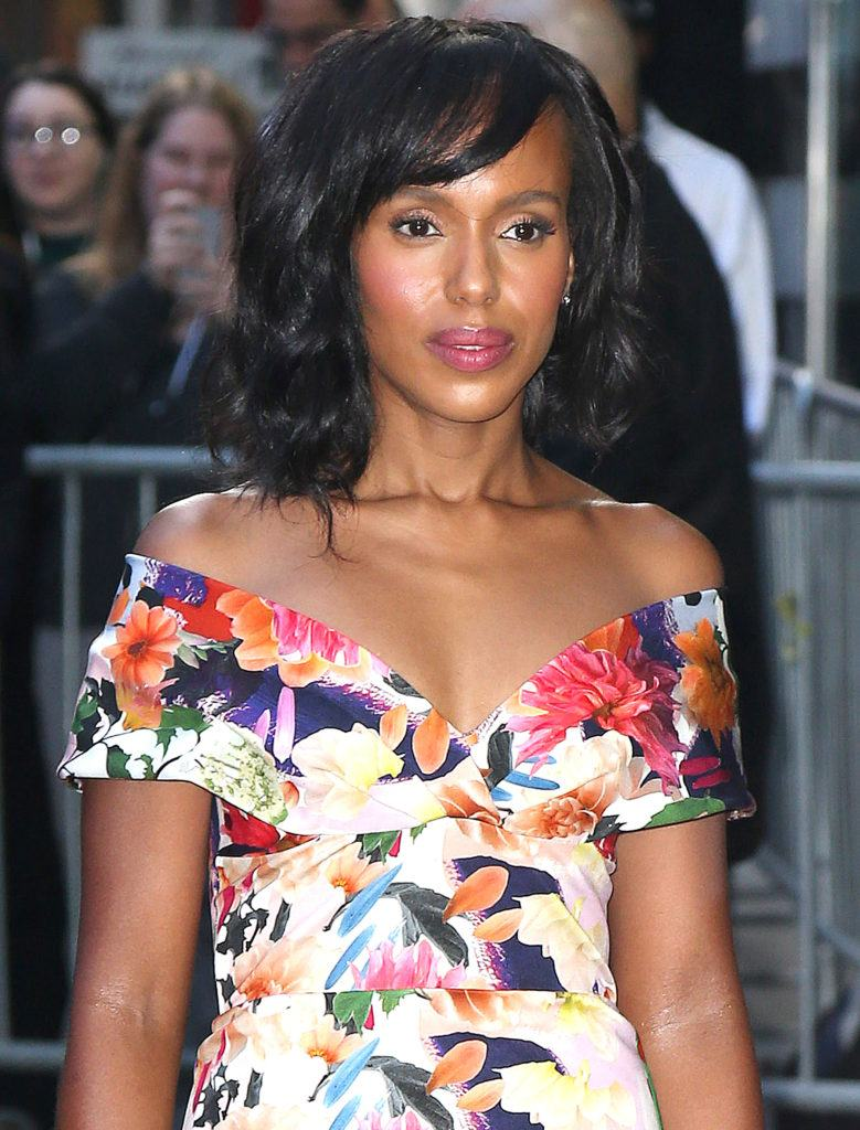 Kerry Washington's wavy hair and bangs hairstyle wearing a floral dress on the red carpet