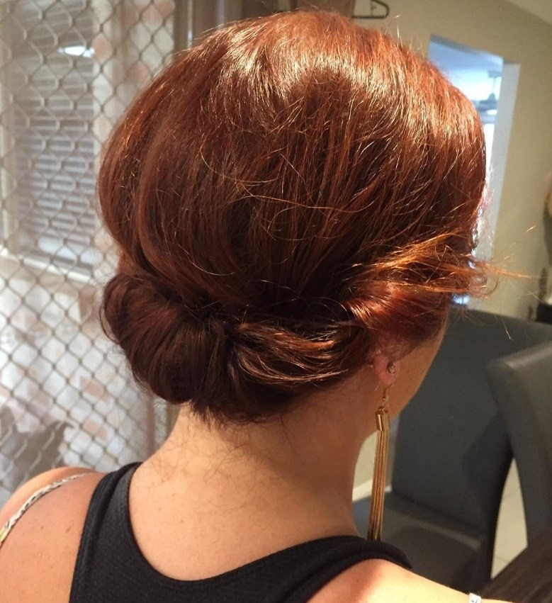 hairstyles for short hair for school: ginger woman with short hair styled into a rolled updo