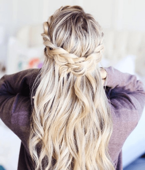 back view of a woman with blonde hair in two braids with space buns - braid hairstyles 2017
