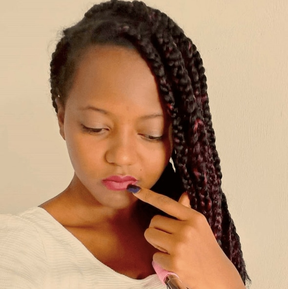 front facing image of a woman with long twist braids - braid hairstyles 2017
