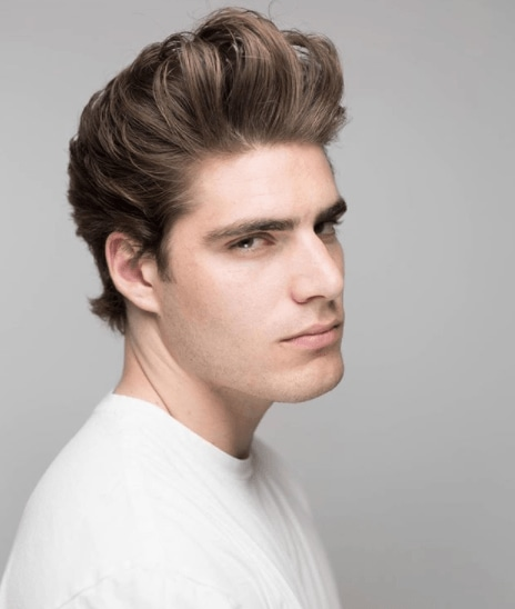 front view image of a man with a voluminous quiff hairstyle