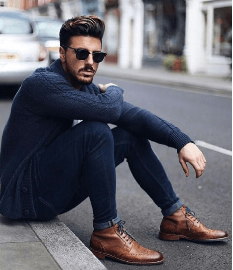 front view image of a man with a quiff hairstyle and trendy clothes