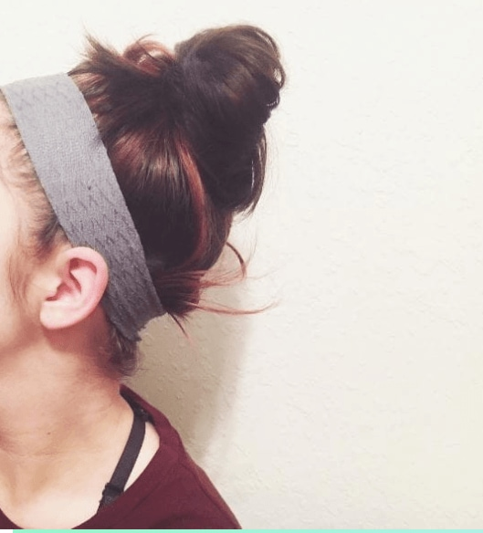 Gym hairstyles for short hair: Brunette messy bun with sporty headband