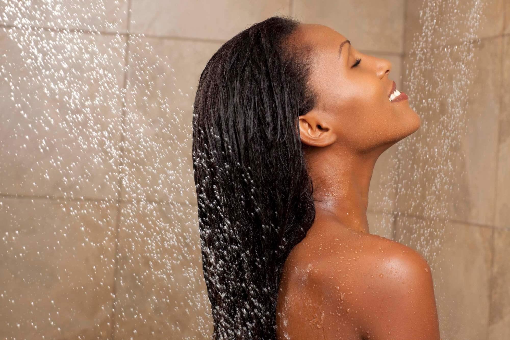 Black woman enjoying a shower