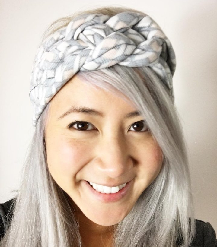 asian woman with silver hair wearing a knotted headband
