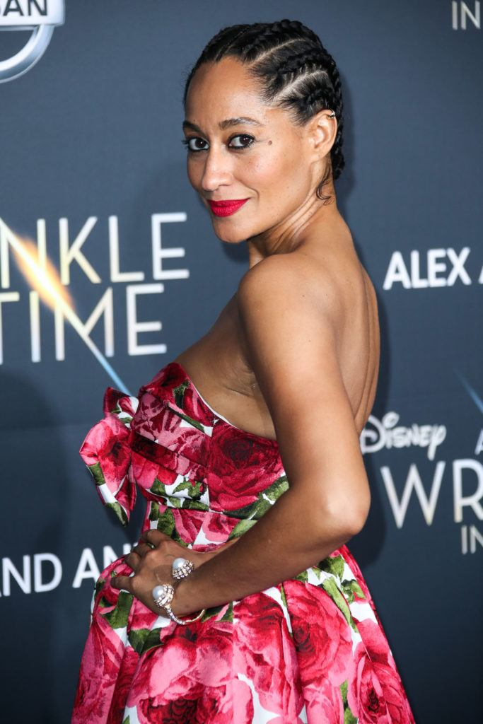 close up shot of tracee ellis ross with straightback cornrows fashioned into a low bun