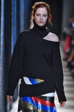 model wearing black outfit and twisted bun hairstyle