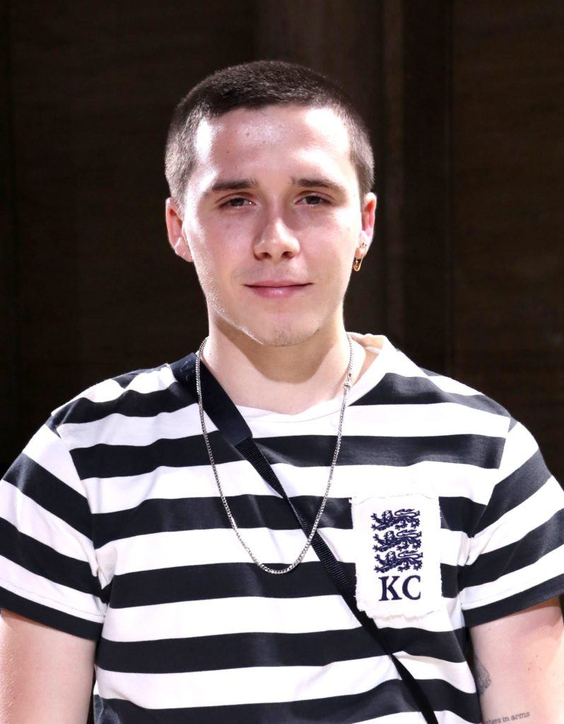 Brooklyn Beckham with a short buzzcut hairstyle