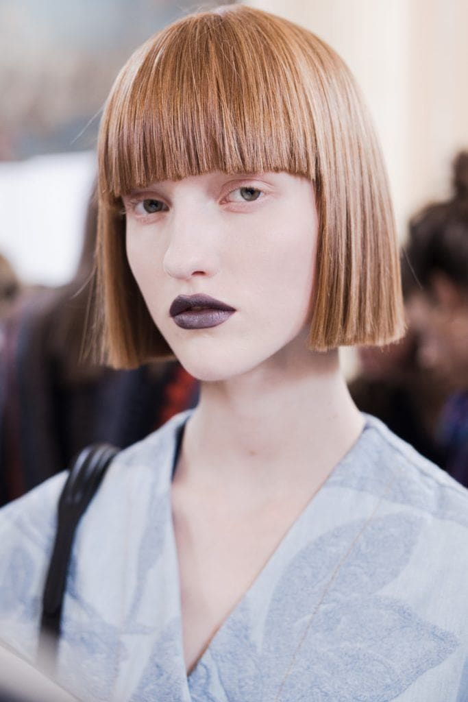 pictures of short hairstyles: model backstage with short bob and blunt bangs