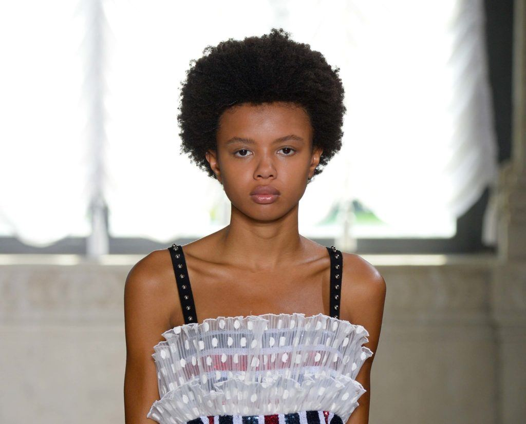 short hair fashion: black model with afro hair on the runway