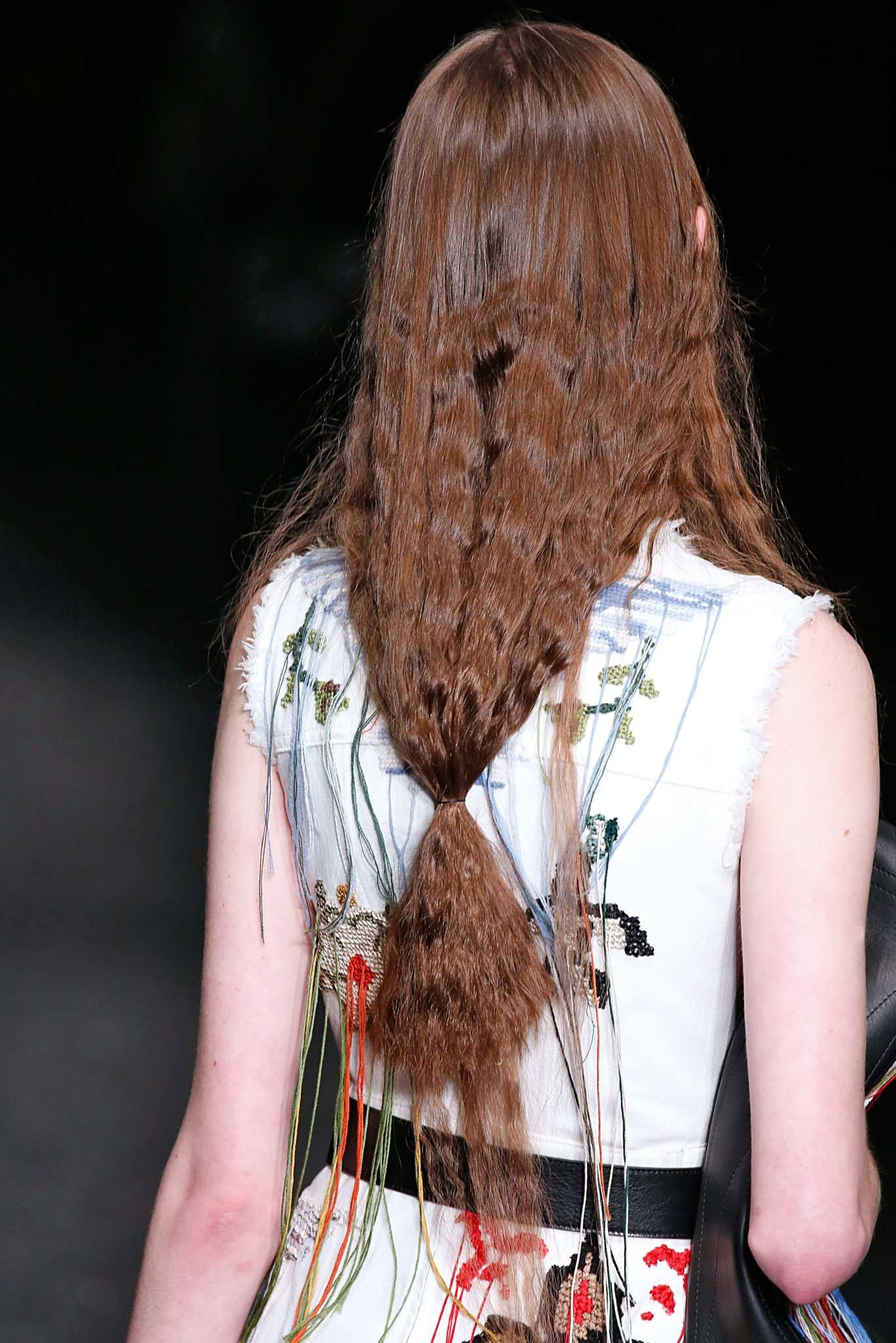 brunette model at alexander mcqueen pfw show with low ponytail