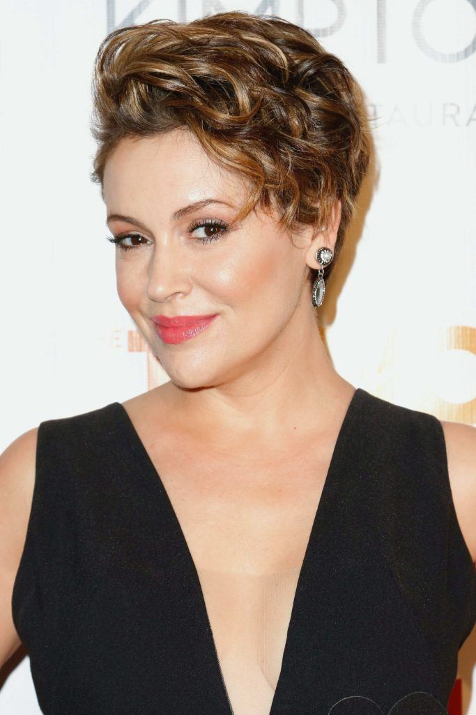 Alyssa Milano with a wavy graduated pixie crop hairstyle, wearing a black dress