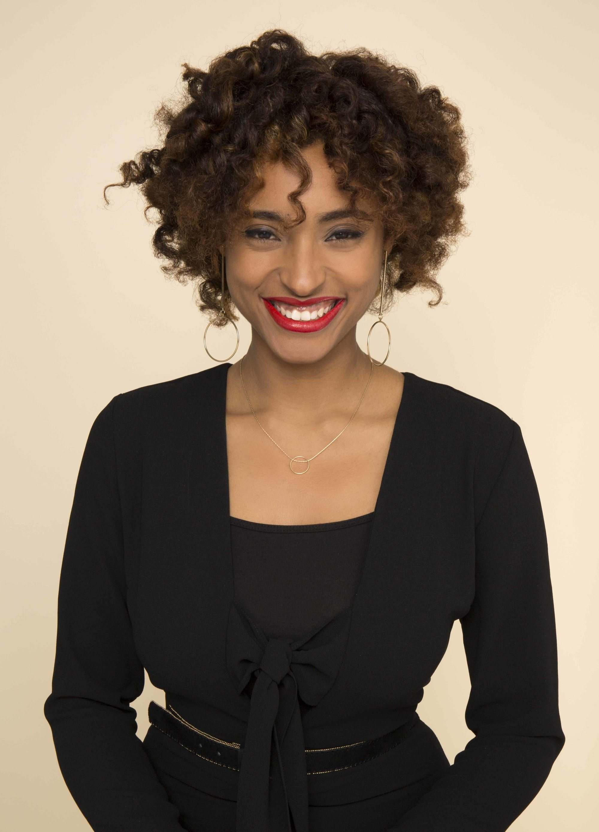 Natural haired model with curly afro