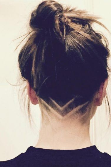 brunette with arrow shaped shaved hair designs
