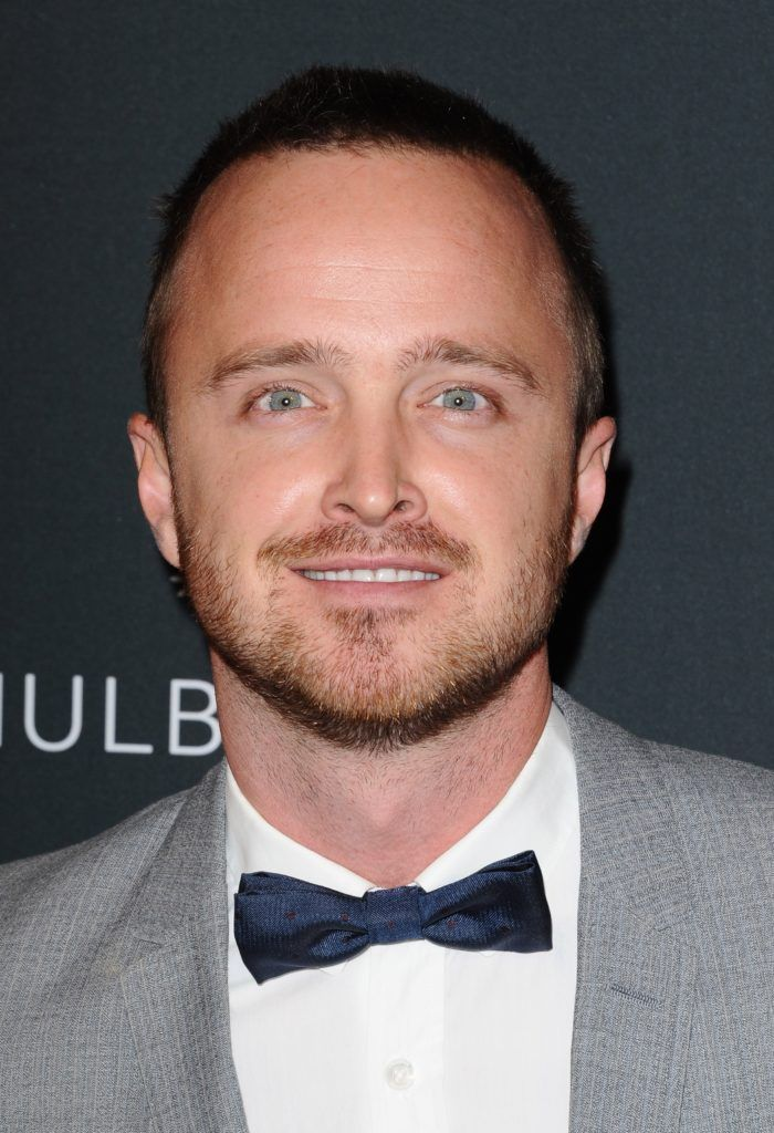 Aaron Paul with a buzz cut, mustache and facial hair
