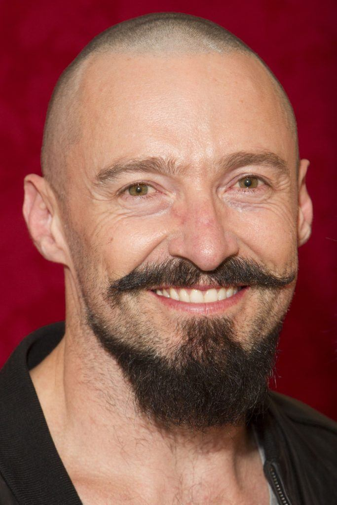Hugh Jackman with a buzzcut and handle bar mustache