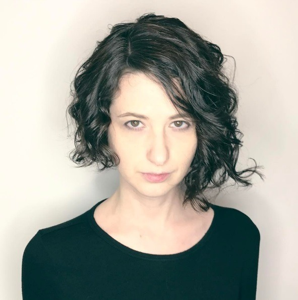 Want to get an asymmetrical haircut discover these 5 great looks asymmmetrical haircuts dark haired woman with naturally curly hair short asymmetrical solutioingenieria Images