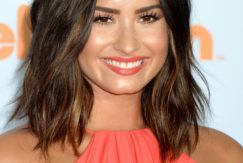 demi lovato at the kids choice awards 2017 with a brunette lob hairstyle