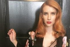 emma roberts with orange hair colour with red lipstick wearing a kimono