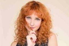 girl with red ginger curly hair and fringe