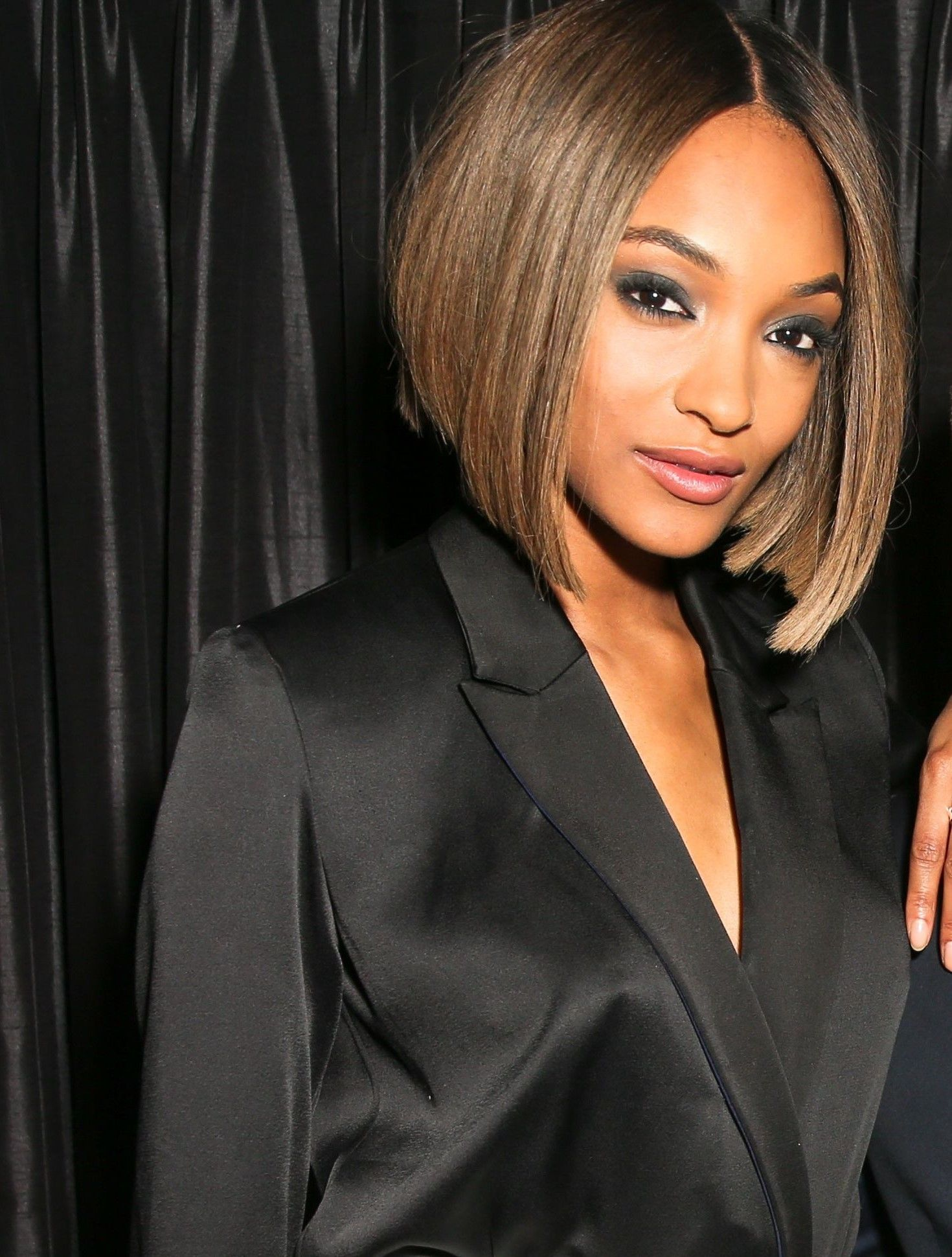 Jourdan dunn with a smooth and sleek caramel graduated bob hairstyle on the red carpet