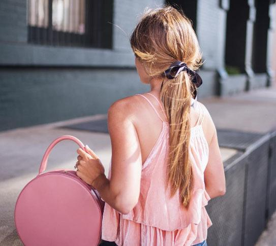 julia hengel with spring hair tie on a low ponytail