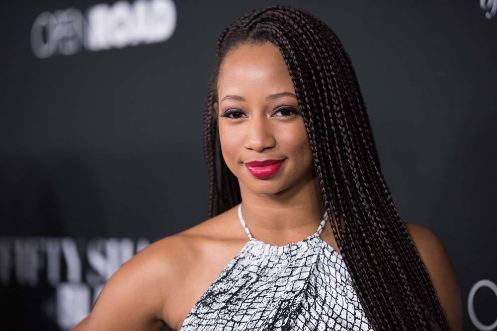 poetic justice hairstyles: side swept box braids as demonstrated by monique coleman